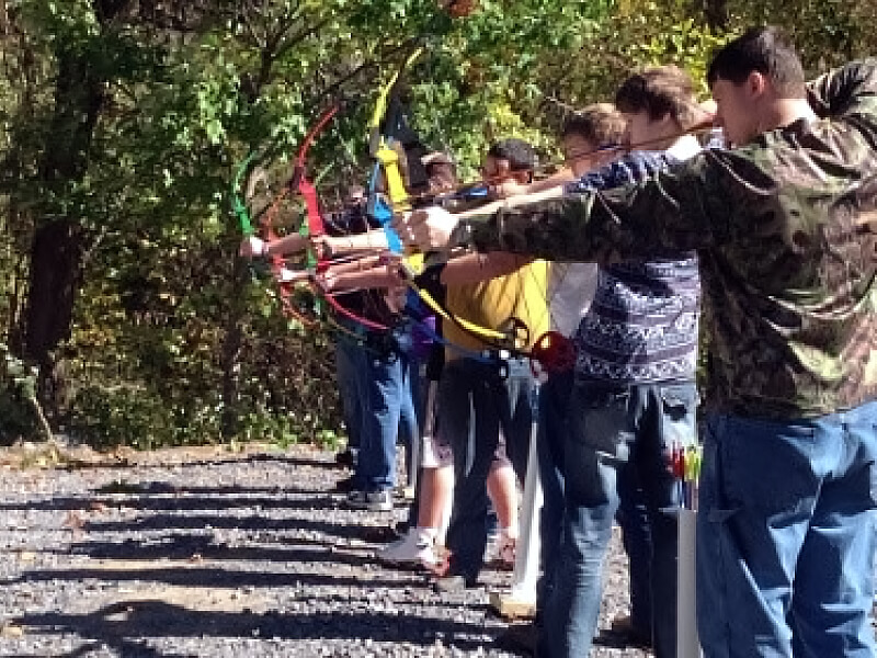 A group of McDowell Choices kids practice archery skills.